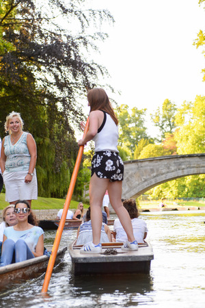 CAMBRIDGE, ENGLAND - JULY 19, 2016: Unidentified girl in a boat over the river Cam, Cambridge, England. The original name was the Granta river