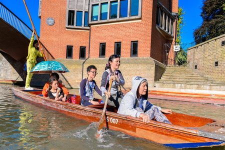 CAMBRIDGE, ENGLAND - JULY 19, 2016: Unidentified people in a boat over the river Cam, Cambridge, England. The original name was the Granta river