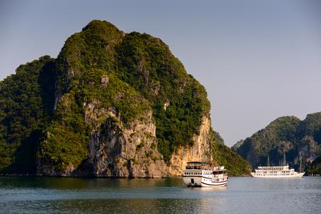 HA LONG BAY, VIETNAM - SEP 23, 2014: Touristic Boat in the Halong bay, Vietnam. UNESCO World Heritage