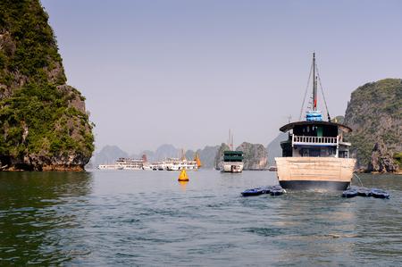 HA LONG BAY, VIETNAM - SEP 23, 2014: Touristic boat at the Halong bay, Vietnam. UNESCO World Heritage Editoriali