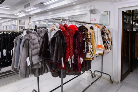 GREECE - APR 22, 2016: Fur coat shop at the factory of Papandopulos in Kastoria, Greece. Very populat brand of Greek made fir coats
