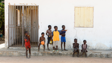 BUBAQUE, GUINEA BISSAU - MAY 5, 2017: Unidentified local children play on the street in a village of the Bubaque island. People in G.-Bissau still suffer of poverty