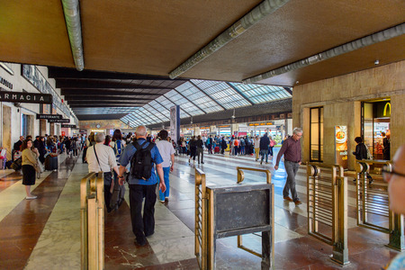 FLORENCE, ITALY - MAY 6, 2016: Passengers at the Firenze Santa Maria Novella, a terminus railway station in Florence.