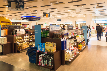 VIENNA, AUSTRIA - DEC 30, 2014: Duty Free secction of the Vienna International Airport, which serves as the hub for Austrian Airlines Stock Photo - 104058157