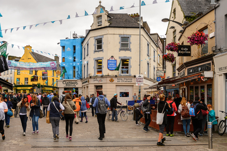 GALWAY, IRELAND - JULY 13, 2016: Crowd in the Shop street in Galway, Ireland. Galway will be European Capital of Culture in 2020