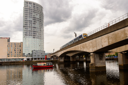 BELFAST, NI - JULY 14, 2016: Bridge over the river Lagan, Belfast, the capital and largest city of Northern Ireland