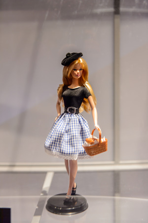 ROME, ITALY - MAY 7, 2016: France style Barbie doll with a basket at the exhibition in Rome. Barbie  brand belongs to the American toy-company Mattel, Inc Redactioneel