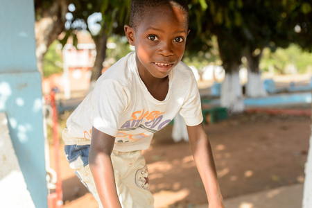 BOLAMA ISLAND, GUINEA BISSAU - MAY 6, 2017: Unidentified local little boy smiles in the ghost town of Bolama, the former capital of Portuguese Guinea