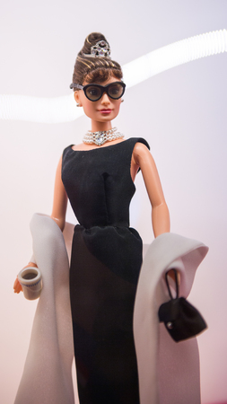 ROME, ITALY - MAY 7, 2016: Barbie doll  as Audrey Hepburn at the Barbie doll exhibition in Rome. Barbie  brand belongs to the American toy-company Mattel, Inc