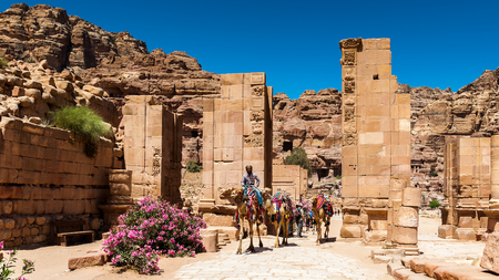 PETRA, JORDAN - APR 29, 2014: Temenes gate in Petra. The city of Petra was lost for over 1000 years. Now one of the Seven Wonders of the Word Editorial