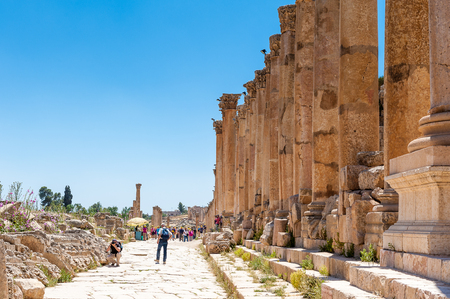 JERASH, JORDAN - MAY 2, 2014: Unidentified tourists in the ancient city Gerasa, modern Jerash. Ancient Roman city of Gerasa reached a size of about 800,000 square meters within its walls.