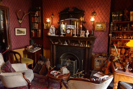 LONDON, ENGLAND - JUL 22, 2016: Main living room of the Sherlock Holmes Museum, 221 Baker Street, London. Sherlock Holmes  is a fictional private detective created by Sir Arthur Conan Doyle