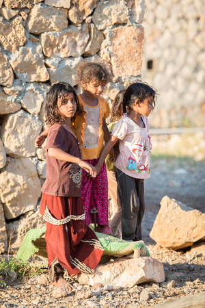 SOCOTRA, YEMEN - JAN 15, 2014: Unidentified Yemeni girls play in the street on the Socotra Archipelago. Children on the  Socotra Archipelago grow without education