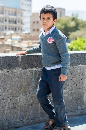 SANAA, YEMEN - JAN 11, 2014: Unidentified Yemeni little boy in the street in Sanaa. Children of Yemen grow up without education