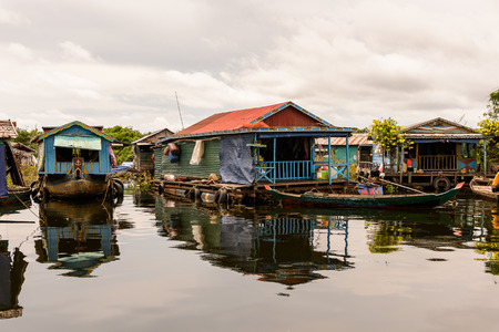 LAKE TONLE SAP, COMBODIA - SEP 28, 2014: Houses of a Floating village Chong Knies on the Tonle Sap. Lake Tonle Sap is the largest freshwater lake in Southeast Asia, a UNESCO biosphere since 1997 Editorial