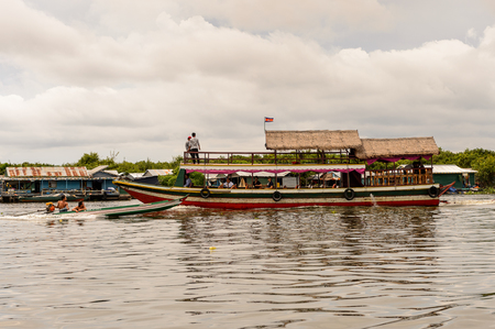 LAKE TONLE SAP, COMBODIA - SEP 28, 2014: Chong Knies Village, Tonle Sap Lake, the largest freshwater lake in Southeast Asia, a UNESCO biosphere since 1997