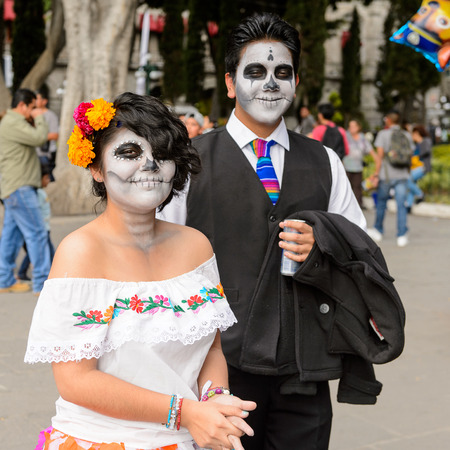 PUEBLA, MEXICO - OCT 30, 2016: Unidentified couple dressed for the Day of the Dead (Dia de los Muertos), national Mexican holiday, UNESCO Intangible Cultural Heritage of Humanity