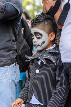 OAXACA, MEXICO - OCT 31, 2016: Unidentified boy painted as zombie for the Day of the Dead (Dia de los Muertos), national Mexican holiday, UNESCO Intangible Cultural Heritage of Humanity Editorial
