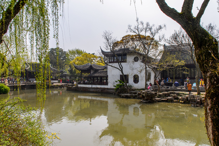 SUZHOU, CHINA - APR 1, 2016: Unidentified tourists at the The Humble Administrator's Garden,  a Chinese garden in Suzhou, a UNESCO World Heritage Site
