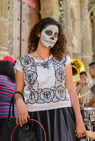 OAXACA, MEXICO - OCT 31, 2016: Unidentified girl painted for the Day of the Dead (Dia de los Muertos), national Mexican holiday, UNESCO Intangible Cultural Heritage of Humanity Editorial