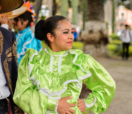 PUEBLA, MEXICO - OCT 30, 2016: Unidentified woman wears the national costume for the Day of the Dead (Dia de los Muertos), national Mexican holiday, UNESCO Intangible Cultural Heritage of Humanity