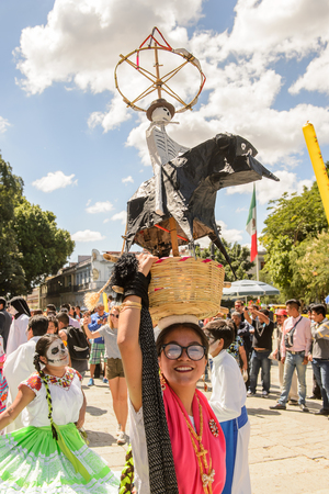 OAXACA, MEXICO - OCT 31, 2016: Unidentified girl dances with a basket for the Day of the Dead (Dia de los Muertos), national Mexican holiday, UNESCO Intangible Cultural Heritage of Humanity