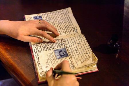 AMSTERDAM, NETHERLANDS - OCT 26, 2016: Anne Frank handwriting, Madame Tussauds wax museum in Amsterdam. One of the popular touristic attractions