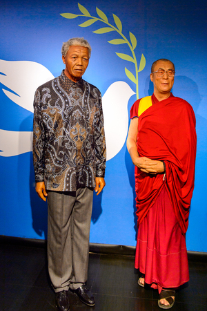 AMSTERDAM, NETHERLANDS - OCT 26, 2016: Nelson Mandela and Dalai Lama, Madame Tussauds wax museum in Amsterdam. One of the popular touristic attractions