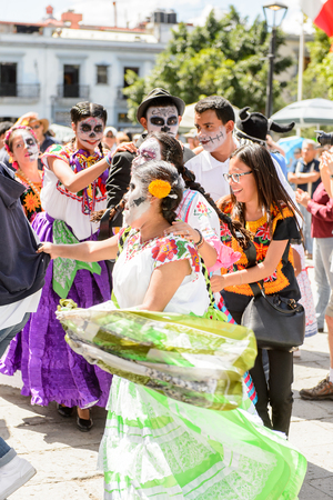 OAXACA, MEXICO - OCT 31, 2016: Unidentified people dance and celebrate the Day of the Dead (Dia de los Muertos), national Mexican holiday, UNESCO Intangible Cultural Heritage of Humanity Editorial