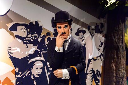 AMSTERDAM, NEDERLAND - 26 oktober 2016: Sir Charles Spencer Charlie Chaplin, een Engelse komische acteur, filmmaker, wassenbeeldenmuseum Madame Tussauds in Amsterdam. Een van de populaire toeristische attracties