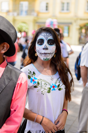 OAXACA, MEXICO - OCT 31, 2016: Unidentified girl dressed as zombie for the Day of the Dead (Dia de los Muertos), national Mexican holiday, UNESCO Intangible Cultural Heritage of Humanity