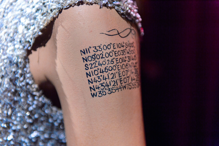 AMSTERDAM, NETHERLANDS - OCT 26, 2016: Tattoo of Angelina Jolie, American actress, filmmaker and humanitarian,  Madame Tussauds wax museum in Amsterdam. One of the popular touristic attractions