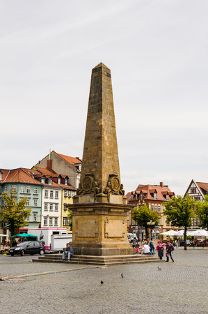 ERFURT, GERMANY  - JUN 16, 2014: Obelisk on the Main market square of Erfurt, Germany. Erfurt is the Capital of Thuringia and the city was first mentioned in 742