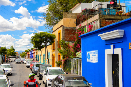 OAXACA, MEXICO - OCT 31, 2016: Small colorful houses on the typical street of Oaxaca de Juarez, Mexico. The name of the town is derived from the Nahuatl name Huaxyacac