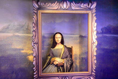 AMSTERDAM, NETHERLANDS - OCT 26, 2016: Leonardo Da Vinci's Mona Lisa, Madame Tussauds wax museum in Amsterdam. One of the popular touristic attractions Editorial