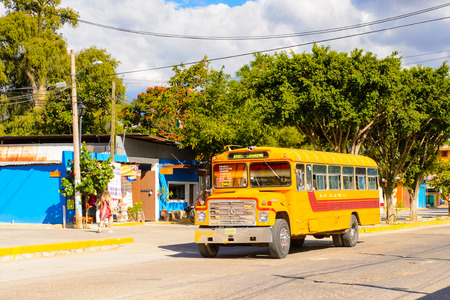SANTA MARIA DEL TULE, MEXICO - OCT 31, 2016: School bus in Santa Maria del Tule, Mexico, Valles Centrales region. The name comes from the Nahuatl word tulle which means bulrush Editorial