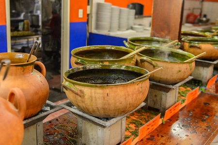 OAXACA, MEXICO - NOV 1, 2016: Local soups in the Restaurant La Choza del Chef in Oaxaca, the place with national Mexican food