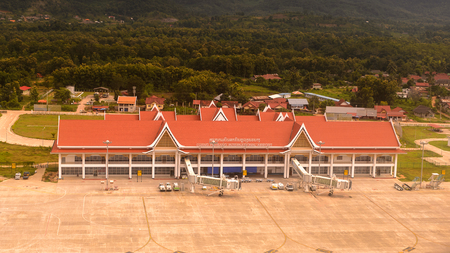 LUANG PRABANG, LAOS - SEP 26, 2014: Aerial view of the Luang Prabang International Airport. Since 2013 it's capable to recieve all large-sized aircraft except the Airbus A380 Editorial