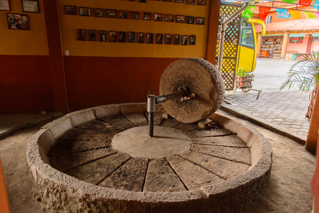 OAXACA, MEXICO - OCT 31, 2016: Fabric of Mezcal called El Rey de Matatlan (near Oaxaca, Mexico), which  produces a distilled alcoholic beverage from any type of agave, the plant with Mexican origin.