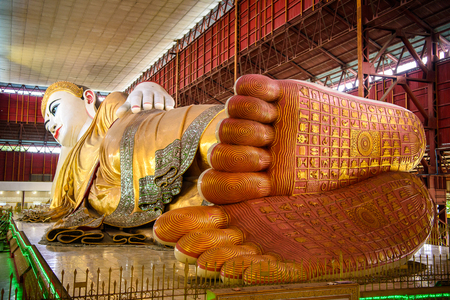 YANGON, MYANMAR - AUG 24, 2016: Giant statue of reclining Buddha at the Chaukhtatgyi Temple, the most well-known Buddhist temple in Bahan Township, Yangon, Myanmar.