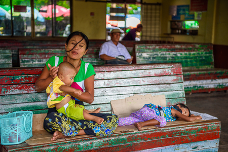 YANGON, MYANMAR - AUG 24, 2016: Unidentified Burmese girl and her little smily child. 68 per cent of Myanma people belong to Bamar ethnic group Editöryel