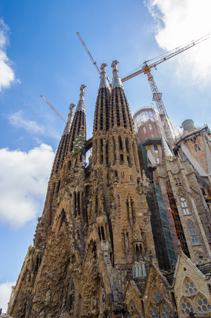 BARCELONA, SPAIN - JUN 23, 2014: Basilica and Expiatory Church of the Holy Family, is a Roman Catholic church in Barcelona, Spain, designed by Antoni Gaudi. UNESCO World Heritage Site