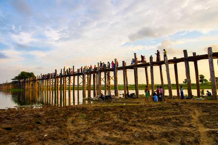 TAUNGTHAMAN LAKE, MYANMAR - AUG 25, 2016: U Bein Bridge over the Taungthaman Lake, the oldest and longest teakwood bridge in the world