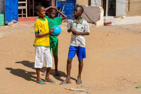 SAINT LOUIS, SENEGAL - APR 24, 2017: Unidentified Senegalese three little boys hang out in Saint Louis, one of the biggest cities in Senegal Editorial