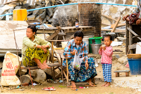 MONYWA, MYANMAR - AUG 27, 2016: Unidentified Burmese people in the street. 68 per cent of Myanma people belong to Bamar ethnic group