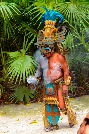 XCARET, MEXICO - NOV 8, 2015: Unidentified man with a body paint dressed as the Maya indian. The Mayan are a group of Indigenous people of Mesoamerica Editorial