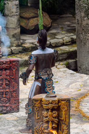 XCARET, MEXICO - NOV 8, 2015: Unidentified man with a bodypaint dressed as the Maya indian. The Mayan are a group of Indigenous people of Mesoamerica Editorial
