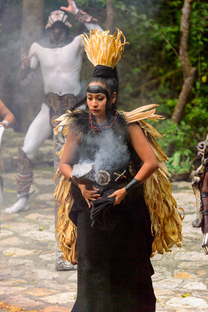 XCARET, MEXICO - NOV 8, 2015: Unidentified girl wears a costume of a Maya indian. The Mayan are a group of Indigenous people of Mesoamerica