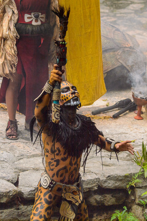 XCARET, MEXICO - NOV 8, 2015: Unidentified man wears the leopard body paint of a Maya indian. The Mayan are a group of Indigenous people of Mesoamerica