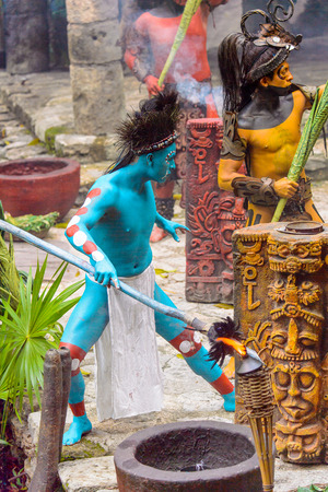 XCARET, MEXICO - NOV 8, 2015: Unidentified man with the blue body paint dressed as the Maya indian. The Mayan are a group of Indigenous people of Mesoamerica